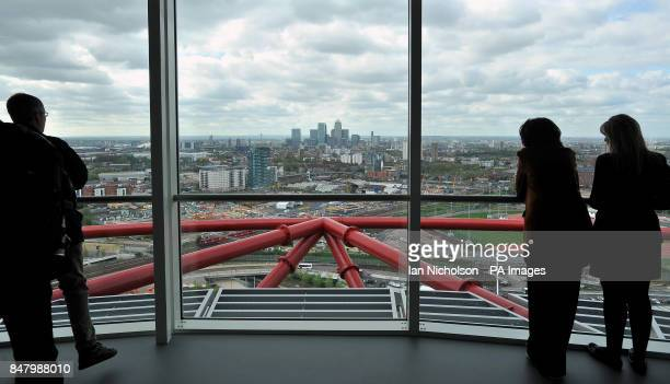 A view across London towards Canary Wharf from the newly completed ArcelorMittal Orbit The sculpture was designed by Anish Kapoor and Cecil Balmond...