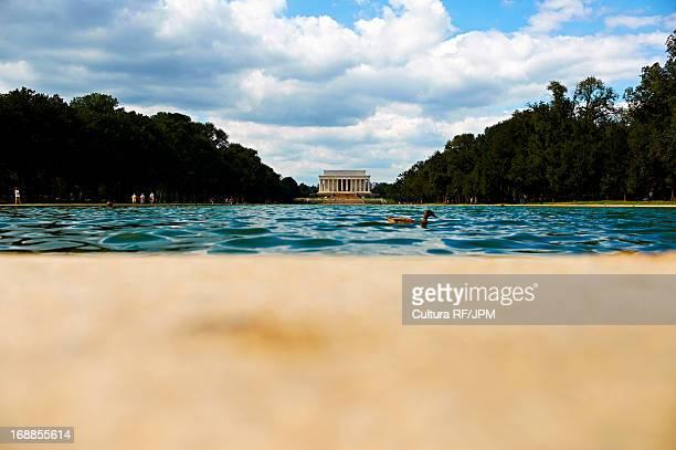 View across reflecting pool to Lincoln Memorial, Washington DC, USA