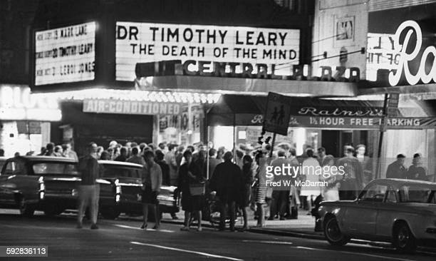 View across Second Avenue of a crowd of people under the marquee for the Fillmore East which advertises 'Dr Timothy Leary The Death of the Mind' New...