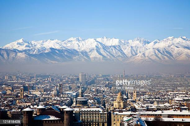 view across snow covered mountains, turin, italy - turin stockfoto's en -beelden