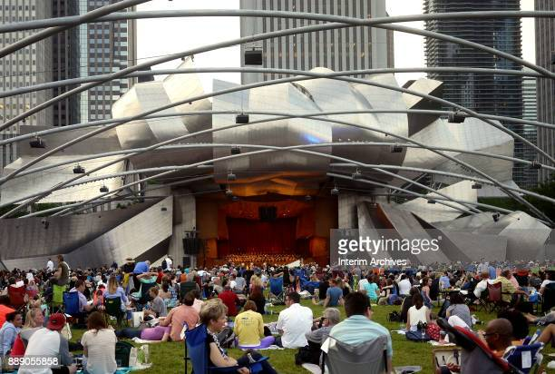 View across the audience as they watch a concert at the Jay Pritzker Pavilion on the Great Lawn at Millennium Park Chicago Illinois June 27 2014
