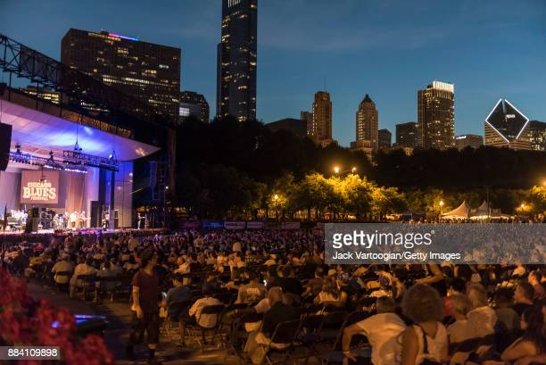 View across the audience at the Petrillo Music Shell stage as they watch American Funk and Soul band Fred Wesley and the New JBs perform during the...