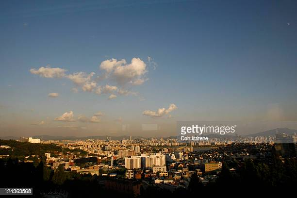 A view across the city including the mountains and skyscrapers in the Gangnam business district on September 5 2011 in Seoul South Korea The South...