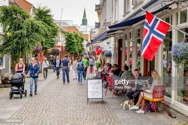 norway - stavanger - downtown - people - kirkegata - norwegian flag stock pictures, royalty-free photos & images