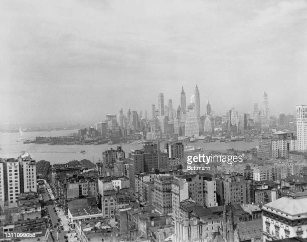 View across the East River towards Manhattan as seen from over the rooftops of the borough of Brooklyn, New York City, New York, 8th May 1936.