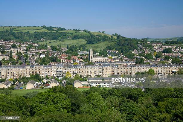 view across the historic city of bath with rows of georgian houses and the grand abbey - bath england stock pictures, royalty-free photos & images