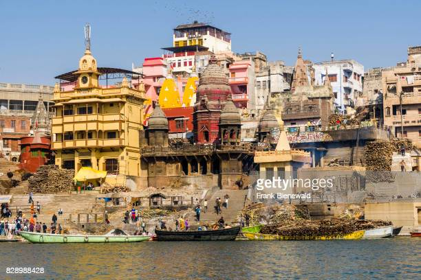 View across the holy river Ganges on Manikarnika Ghat Burning Ghat in the suburb Godowlia