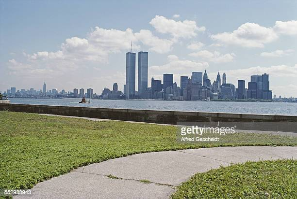 A view across the Hudson River from Ellis Island toward Lower Manhattan showing the twin towers of the World Trade Center New York City June 1979