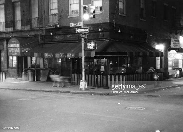 View across the intersection of Bleeker and MacDougal streets in the Greenwich Village neighborhood at the Cafe Figaro closed for the night New York...