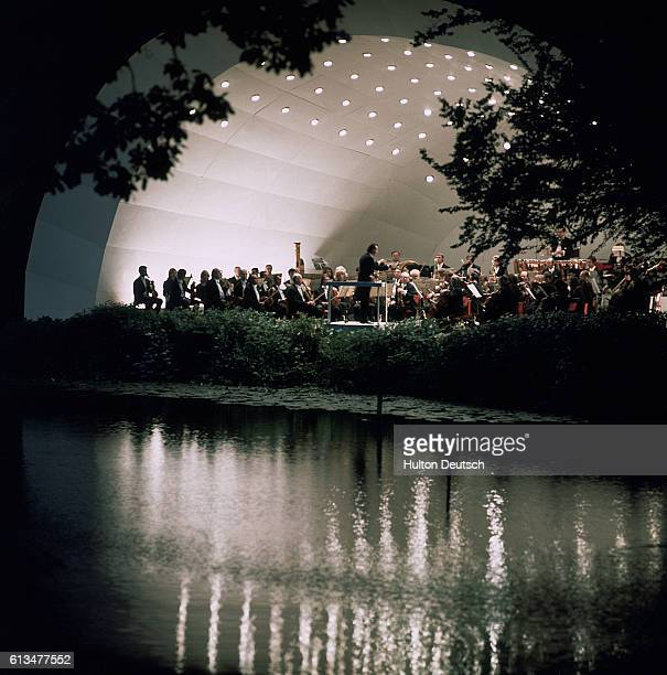 View across the lake of the orchestra during an evening performance at Kenwood House in Hampstead.