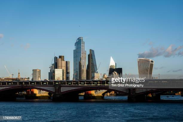 view across the river thames of the city of london skyscrapers - economic stimulus stock pictures, royalty-free photos & images