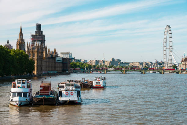 View across the River Thames, taking in London Bridge, Big Ben, the Houses of Parliament and river cruiser boats on the river