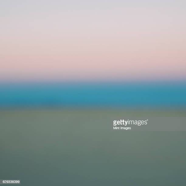 View across the sky and the horizon line at dawn in the desert.