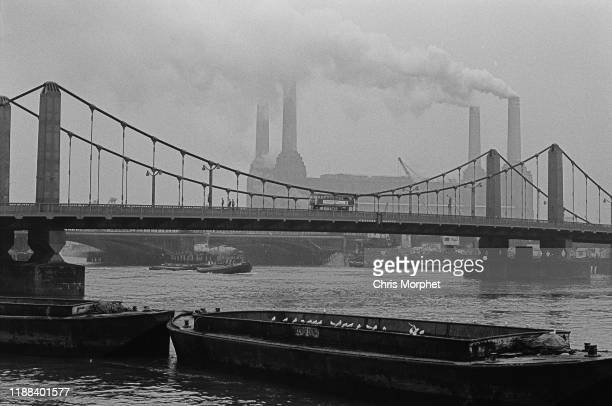 A view across the Thames towards Battersea Power Station with Chelsea Bridge in the foreground London 28th December 1966