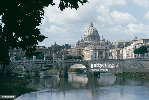 A view across the Tiber river towards St Peter's Basilica in Vatican City circa 1960