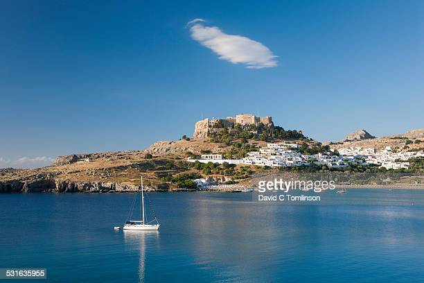 view across tranquil lindos bay, lindos, rhodes - lindos stock photos and pictures