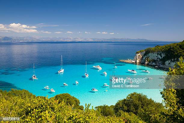 view across turquoise sea, voutoumi bay, antipaxos - greece stock pictures, royalty-free photos & images