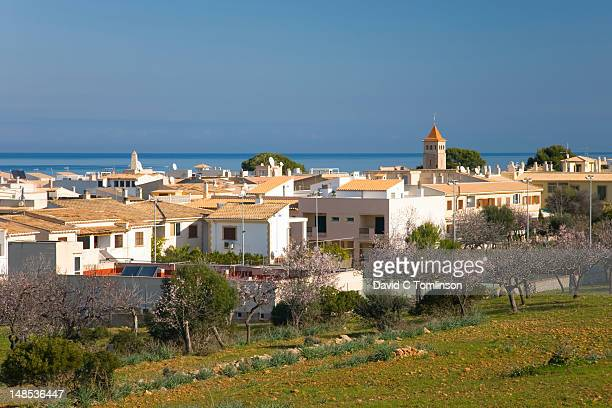 View across village rooftops to the Badia dÆAlcudia.