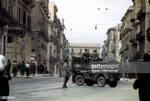 A view Allied forces drive though town after the invasion of Sicily called Operation Husky during the World War II in Palermo Sicily Italy