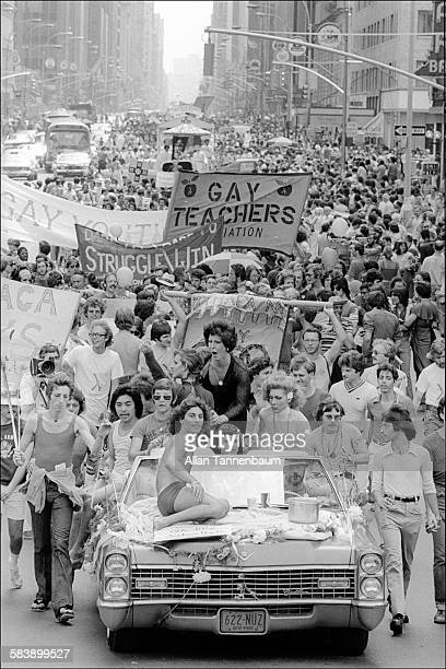 View along 6th Avenue as hundreds of people march towards Central Park in a Gay Pride Parade New York New York June 26 1975