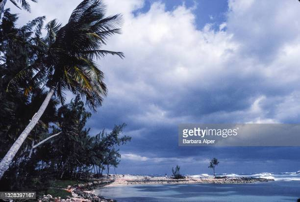 View, along a beach, of gathered clouds over the ocean, Paradise Island, Bahamas, December 27, 1989.