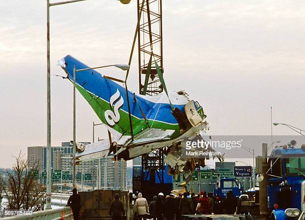 View along a bridge as a section of Air Florida Flight 90 is lifted via crane out of the Potomac River Washington DC January 20 1982 On January 13...