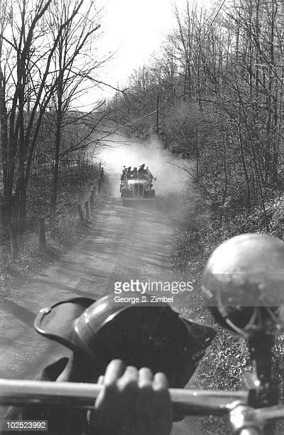 View along a country road from a Putnam County Volunteer Fire Department firetruck at an approaching second firetruck New York early 1960s