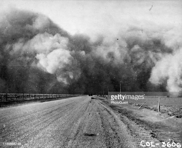 View along a dirt road in Prowers County as a dust storm approaches, Colorado, March 1937. Reportedly, the storm, from the north, had a wind velocity...
