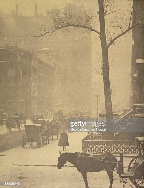 View along a snowy street full of horse drawncarriages 1896