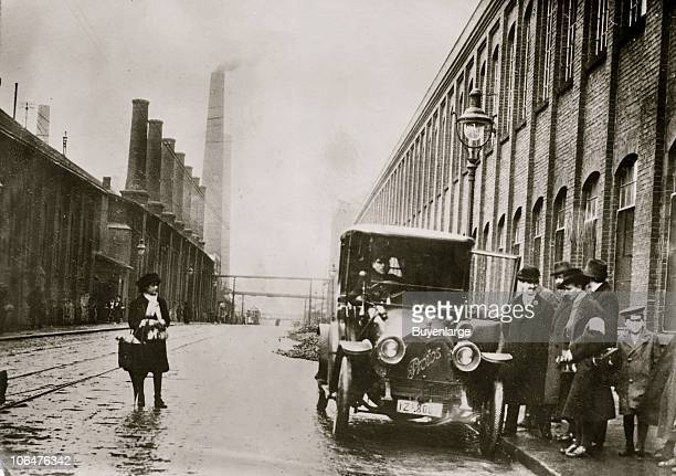 View along a street at the Krupp Steel Works early twentieth century A driver in a Protos automobile waits for the people at right to enter