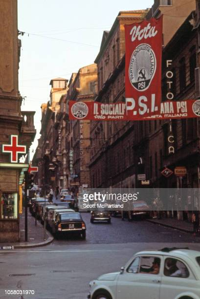 View along a unidentified street over which hang political banners for the Italian Socialist Party Florence Italy August 1968