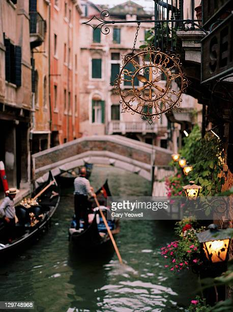 view along a venice canal at dusk - yeowell stock pictures, royalty-free photos & images