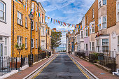 A view along Addington Street, Ramsgate toward the sea. Bunting is flying in preparation for the annual street fair. The street is part of Ramsgate's burgeoning music and art scene.
