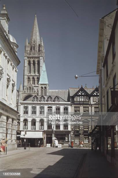 View along Lemon Street of shops lining Boscawen Street with, in the background, the Cathedral of the Blessed Virgin Mary in the city of Truro in...