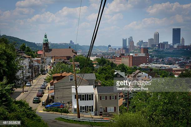 A view along Mission Street on the South Side Slopes shows the highrises of downtown Pittsburgh in the distance on July 11 2015