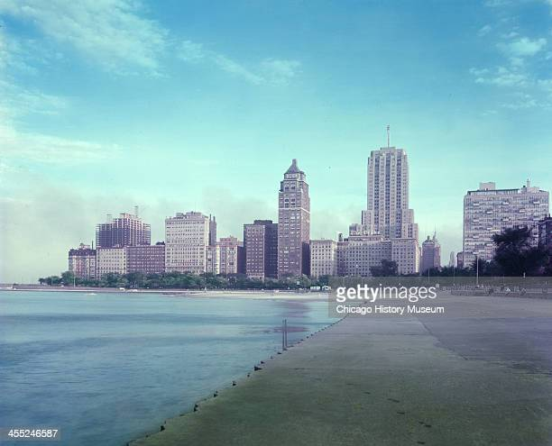 View along Oak Street Beach of the downtown skyline Chicago Illinois mid 20th century Among the visible structures are the Palmolive Building and the...