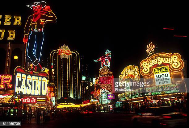 View along of hotels casinos and their neon signs along Fremont Street Las Vegas Nevada 1980s or early 1990s