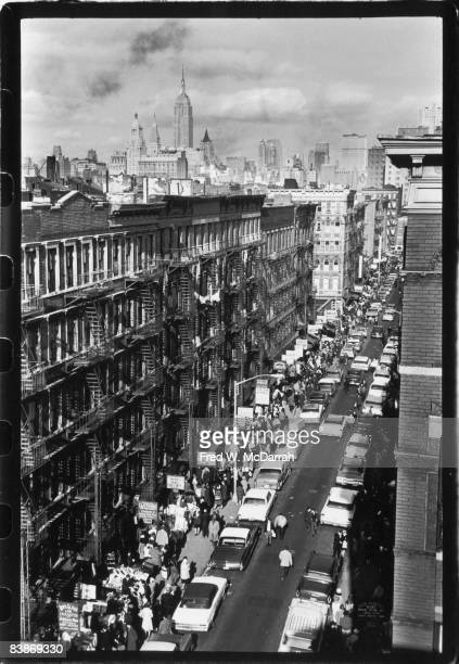 View along Orchard Street from the intersection of Rivington Street on the lower east side of Manhattan December 2 1963 The Chrysler Building is...