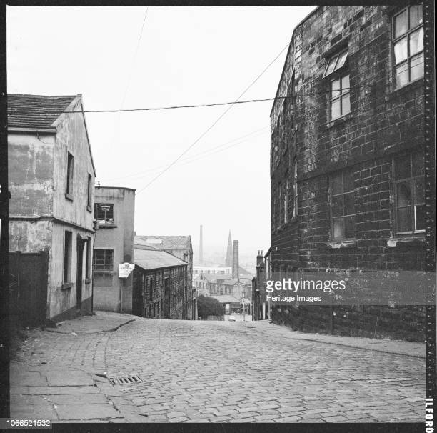 View along Sandygate towards the town centre with the former Neptune Inn in the left foreground and Clock Tower Mill in the right foreground. Artist...