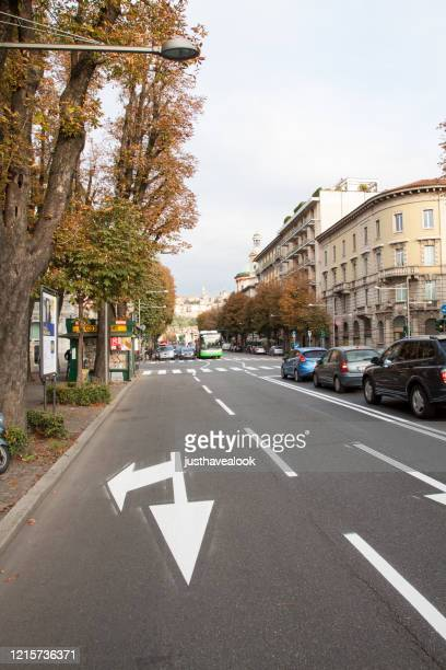 view along street viale papa giovanni xxiii in bergamo - papa giovanni xxiii stock pictures, royalty-free photos & images