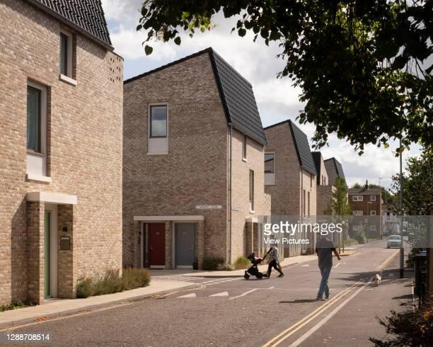 View along street with pedestrians. Goldsmith Street, Norwich, United Kingdom. Architect: Mikhail Riches, 2019.