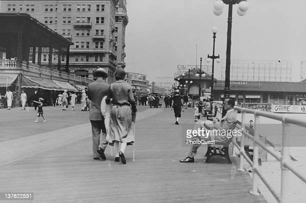 View along the boardwalk in Atlantic City New Jersey 1925 The large building at left is the Hotel Breakers