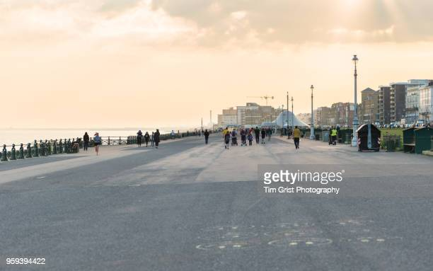 view along the promenade at hove lawns, brighton and hove, uk at dusk - hove stock pictures, royalty-free photos & images