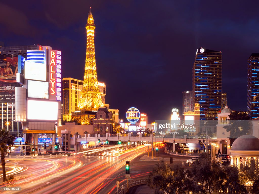 View along the Strip in Las Vegas at night, with the illuminated Paris Las Vegas Hotel and Casino in the background. : Stock Photo