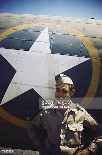 A view as a 376th Bombardment Group member stands by a B24 Liberator at the US Air Force Base in Benghazi Libya