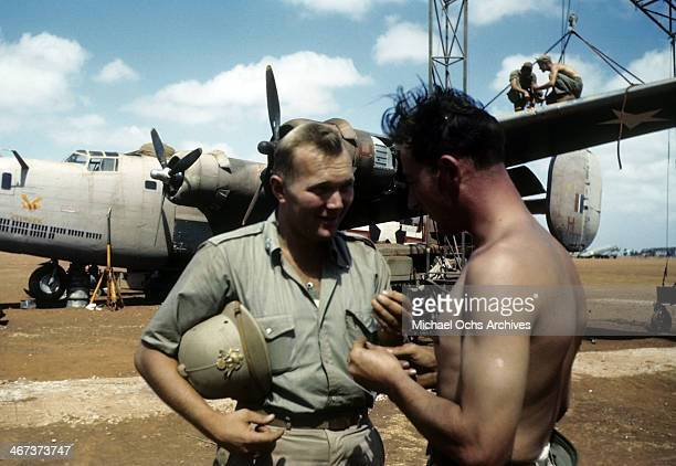 A view as a 389th Bombardment soldier talks to a crew member by a B24 Liberator at the US Air Force base in Benghazi Libya