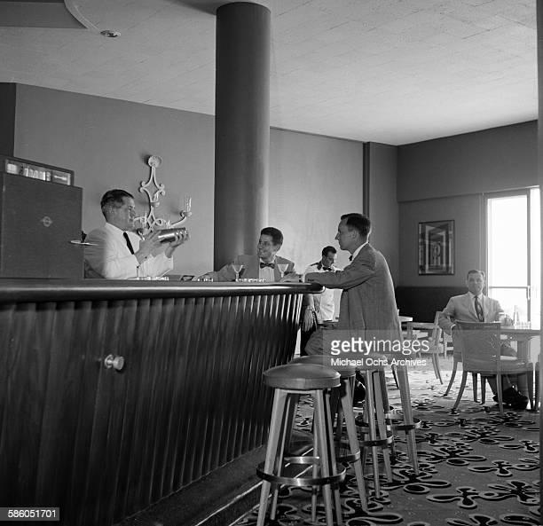 A view as a bartender makes a guest a martini in a bar in Caracas Venezuela