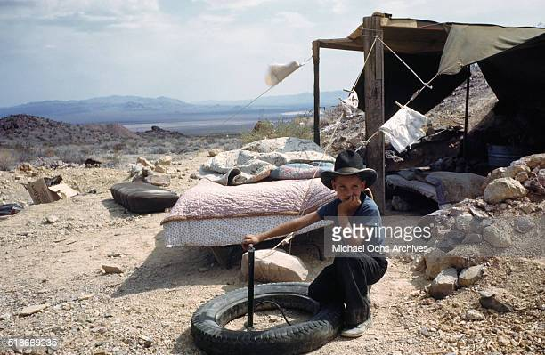A view as a boy plays with a tire in Tent City Nevada housing for workers and thier families at the Basic Magnesium Incorporated a Magnesium Mining...