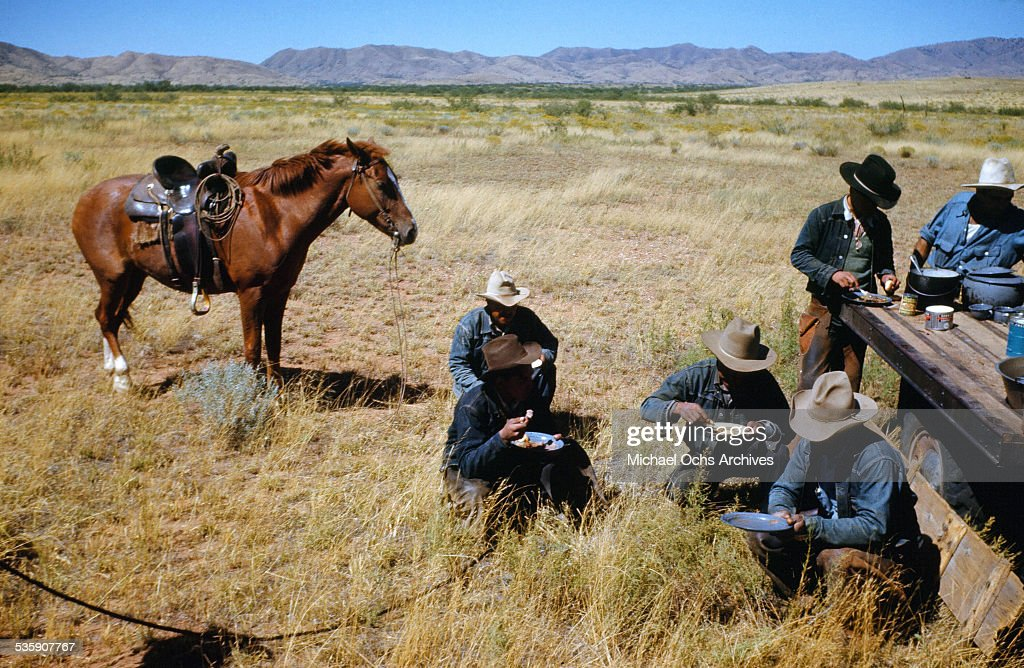 A view as a cattle ranchers and hired hands take a lunch break herding cows in Montana.