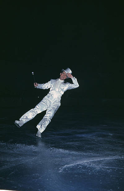 A view as a man performs on ice during the StPaul Winter Carnival in StPaulMinnesota